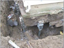 Secondary footing removed and helical piles installed | Montgomery, AL